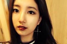 suzy black hair dark red lips