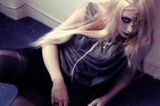 Krystal exudes an edgy goth and witch house concept for 'Red Light.'