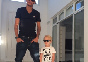 Neymar poses with little Neymar, attitude and all.
