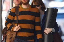 Emma Stone and boyfriend Andrew Garfield hiding from the paparazzi