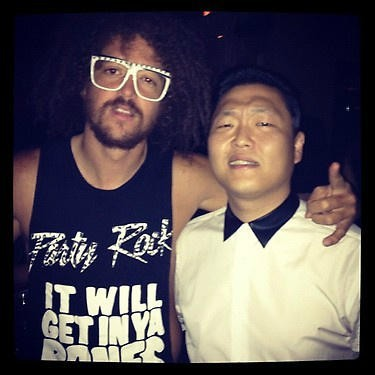 A picture of Psy and Redfoo was taken inside a club.key=>0 count1