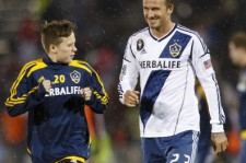 Brooklyn and David Beckham in 2012