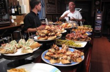 Counter of a bar with a variety of tapas and pinchos, both traditional and more elaborate tapas are a small sample of the renowned Basque cuisine, San Sebastian (Donostia), Guipuzcoa, Basque Country, Spain.