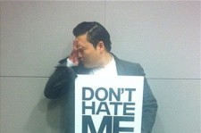 Psy held up a sign that said