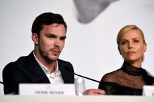 Nicholas Hoult and Charlize Theron.