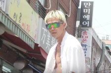 Poppin' Hyun Joon of Young Turks Club in the music video for