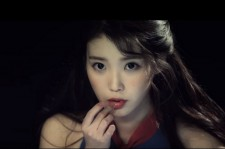 IU Slams her face into a cake in MV Teaser for title track