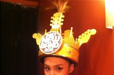 2NE1's Sandara wearing her 2011 Best New Band in the World crown.