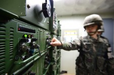 a South Korean soldier turns on speakers blasting K-pop in Korea's DMZ