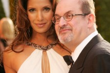 Padma Lakshmi and writer Salman Rushdie arrive at the Vanity Fair Oscar Party at Mortons on March 5, 2006 in West Hollywood, California.