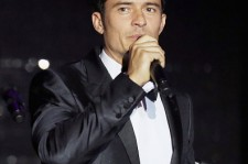 Orlando Bloom appears on stage at the amfAR's 23rd Cinema Against AIDS Gala at Hotel du Cap-Eden-Roc on May 19, 2016 in Cap d'Antibes, France.