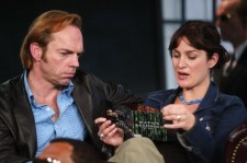 Hugo Weaving and Carrie-Anne Moss look at the soundtrack for The Matrix during a visit from the cast of 'The Matrix Reloaded' on MTV's Total Request Live May 13, 2003 at the MTV Times Square studios in New York City.