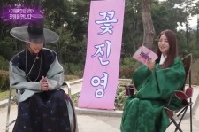 """Still image from the interview with Jin-Young. The backdrop in Hangul read  """"Kkot Jin-Young"""" which means """"Flower boy Jin-Young."""""""