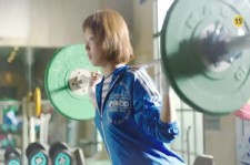 """Still image from the official teaser trailer of MBC drama """"Weightlifting Fairy Kim Bok-Joo"""" showing Lee Sung-Kyung serious training in weightlifting."""