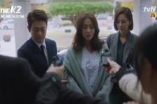 "Still image from the closing scene of ""The K2"" episode 12 when Yoo-Jin admitted that Anna is his husband's daughter."
