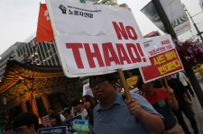 Protesters attend the rally to denounce deploying the Terminal High-Altitude Area Defense (THAAD) near the U.S. embassy on July 13, 2016 in Seoul, South Korea.
