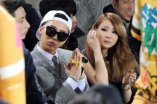 G-Dragon (L), a member of the popular South Korean boyband Big Bang, and CL (R), a member of the K-pop girlband 2ne1, watch a fashion show held in Seoul on March 28, 2013.