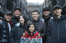 Cast members and director Ryoo Seung-Wan take picture together after wrapping up filming of