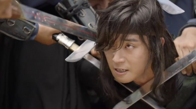 "Still image from ""Hwarang"" Episode 3 as soldiers subdued Moo-Myung who seek revenge for his friend's death."