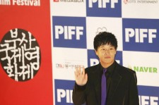 Cha Tae-hyun poses for pictures during the opening ceremony of Pusan International Film Festival on October 6, 2005 in Pusan, South Korea.