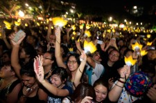 Fans of Korean Pop Band Bigbang watch as they perform at the Singapore Formula 1 Grand Prix on September 20, 2013 in Singapore.