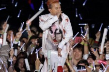 G-Dragon of Bigbang onstage during a PSY concert titled 'Happening' at Olympic Stadium on April 13, 2013 in Seoul, South Korea.