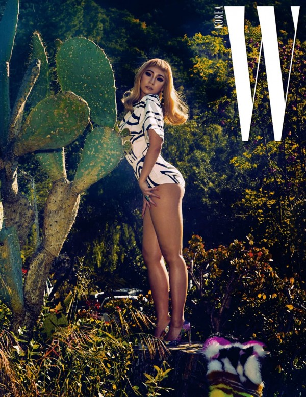 W Korea shared more pictures of CL wearing different swimsuits.key=>1 count4