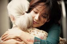 Lee Hyori hugs an elderly woman
